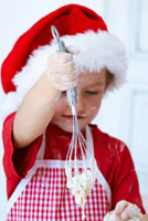 Girl mixing dough with a whisk