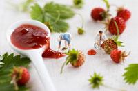 Little toy men among wild strawberries