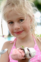Blond girl with an ice cream sundae