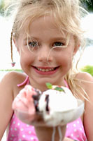 Blond girl with a mixed ice cream sundae