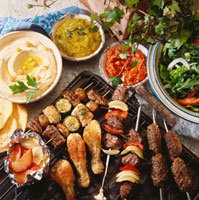 Barbecued food, salad and dips