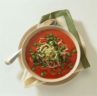 Tomato soup with peas and noodles