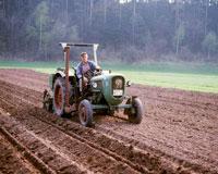 Farmer on tractor preparing field
