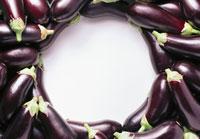 Purple aubergines laid