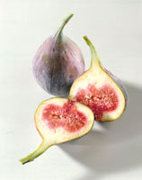 Two fresh figs, one halved