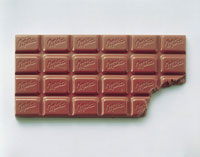 Bar of Milka chocolate, a bite taken