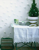 Table with small Christmas tree