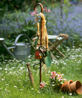 Garden tools hanging up on a stick