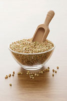 Buckwheat in glass bowl with scoop