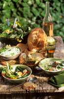 Wild herb dishes on wooden table
