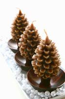 Three pine cone-shaped Christmas candles