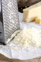 Grated Parmesan with grater