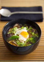 Clear vegetable soup with udon noodles