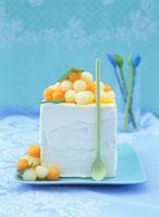 Citrus fruit ice cream with melon balls