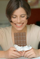 Woman holding a bar of chocolate