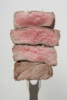 Slices of beef steak on carving fork