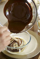 Mixing melted chocolate and custard in a bowl