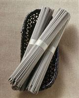 Soba noodles�Cin bundles on a wicker basket