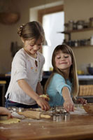 Two girls baking biscuits