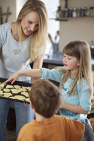 Mother and children baking biscuits