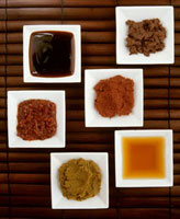 Six different spicy Asian sauces in small dishes