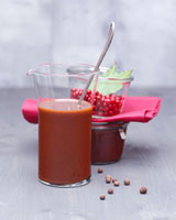 Venison gravy in a glass beaker,spices and preserving jar