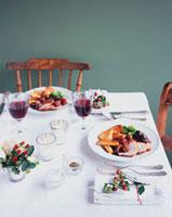 Laid table with plates of roast turkey (Christmas)