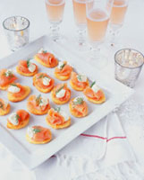 Smoked salmon and potato canapes with sparkling wine