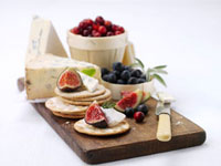 Appetiser: cheese�Cberries�Ccrackers and figs