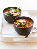 Tomato soup with basil in two bowls