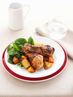 Honey and mustard glazed chicken legs with vegetables