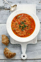 Tomato soup with lentils,couscous and chilli