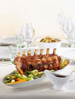 Roast veal with vegetables on festive table