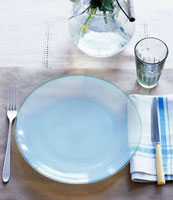 Place-setting with glass plate