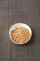 Spelt grains in a paper dish