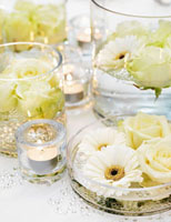 Festive table decoration of white flowers and tealights