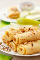 Pancakes with peanut butter,chopped nuts and apple slices