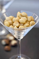 Shelled macadamia nuts in a Martini glass