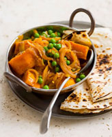 Pumpkin and pea curry with poppadom (India)