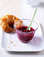 Cherry and cranberry jam with croissant