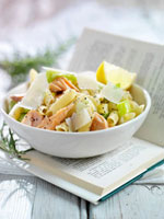 Penne with salmon and leeks on book
