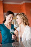 Two women drinking white wine