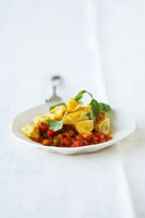Agnolotti with ricotta and fennel filling on peppers