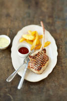 Grilled veal chop with chips,home-made ketchup