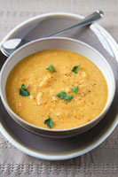 Carrot,Lentil and Coriander Soup in a Bowl; Spoon
