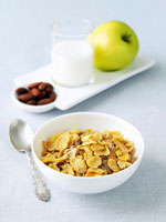Bowl of Cold Cereal; Nuts,Milk and Apple 22199057479| 写真素材・ストックフォト・画像・イラスト素材|アマナイメージズ