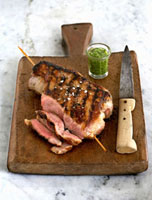 Grilled lamb on wooden board