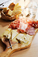 Cold cuts and cheese board with bread