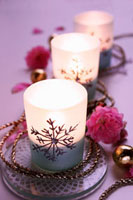 Christmassy tealights with chain and flowers