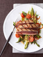 Grilled tuna steak with green asparagus